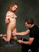 Red-haired slave girl suspended and whipped hard by her Master