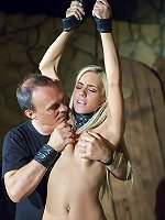 Sexy blonde moans while beind whipped and tormented in mediaval castle